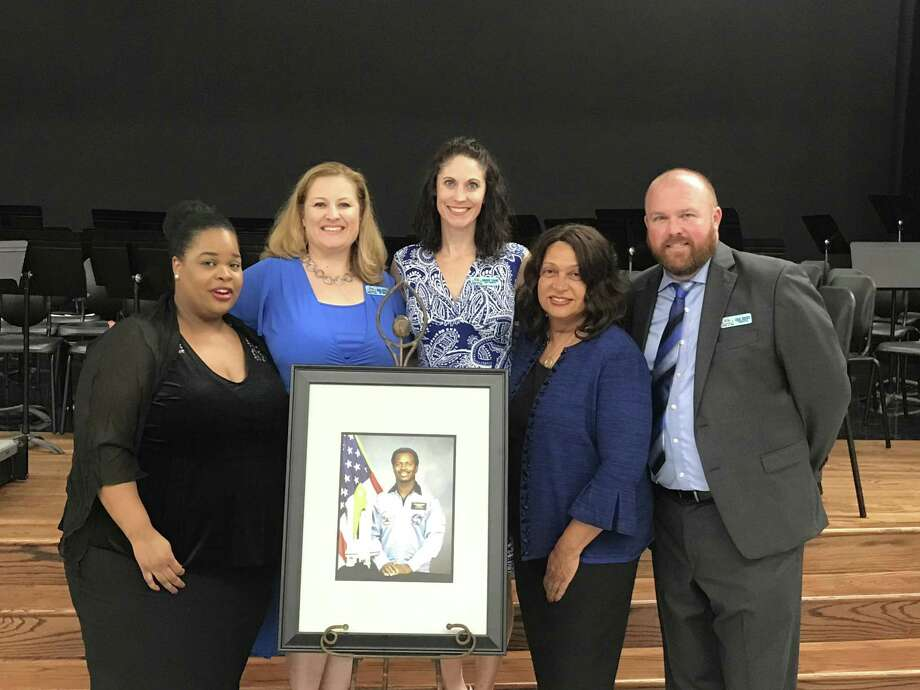 Joy McNair, daughter of the late Challenger astronaut Ronald E. McNair, left, joined Dr. Ronald E. McNair Junior High School assistant principals Marisa Whitfield and Brook Chang, McNair's widow Cheryl McNair and Principal Craig Rhodes at a dedication ceremony at the school. A portrait of the astronaut was provided to the campus.