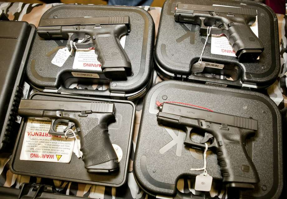 A mix of Glock handguns Photo: JAMES DURBIN / JAMES DURBIN / © 2012 Midland Reporter Telegram. All Rights Reserved.