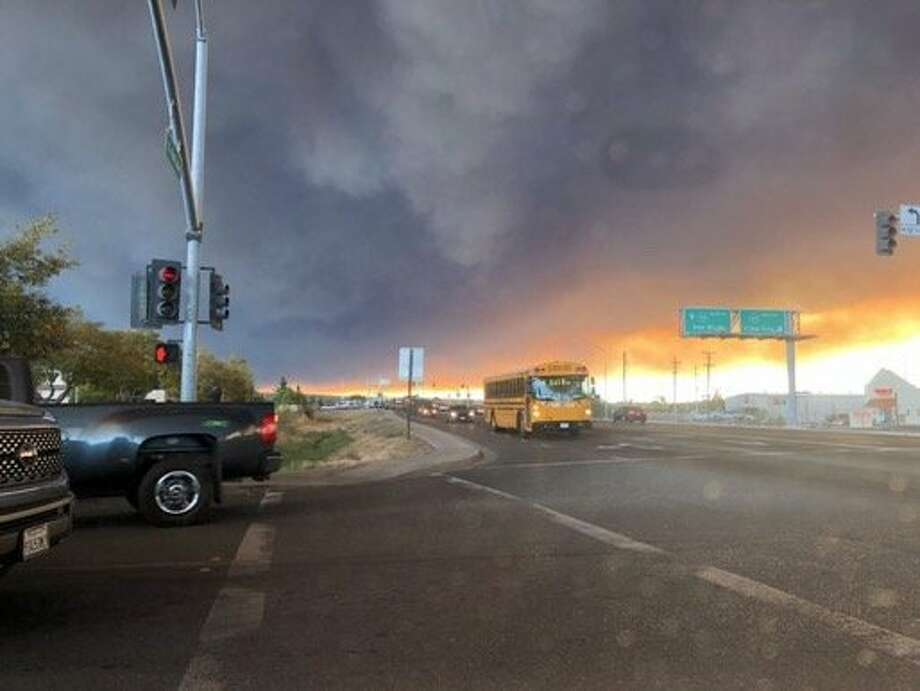 Twitter user jackieglazerr has captured dark smoke from the campfire that filled the sky above Fair Street in Chico. Photo: Twitter