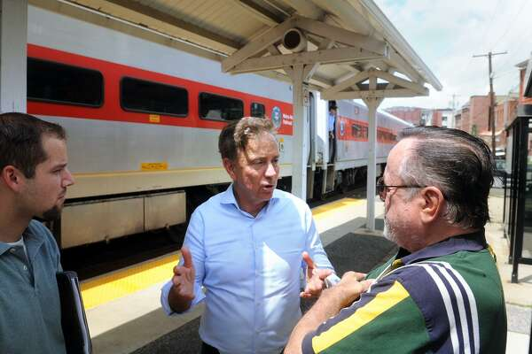 Ned Lamont speaks to commuters during a campaign stop.