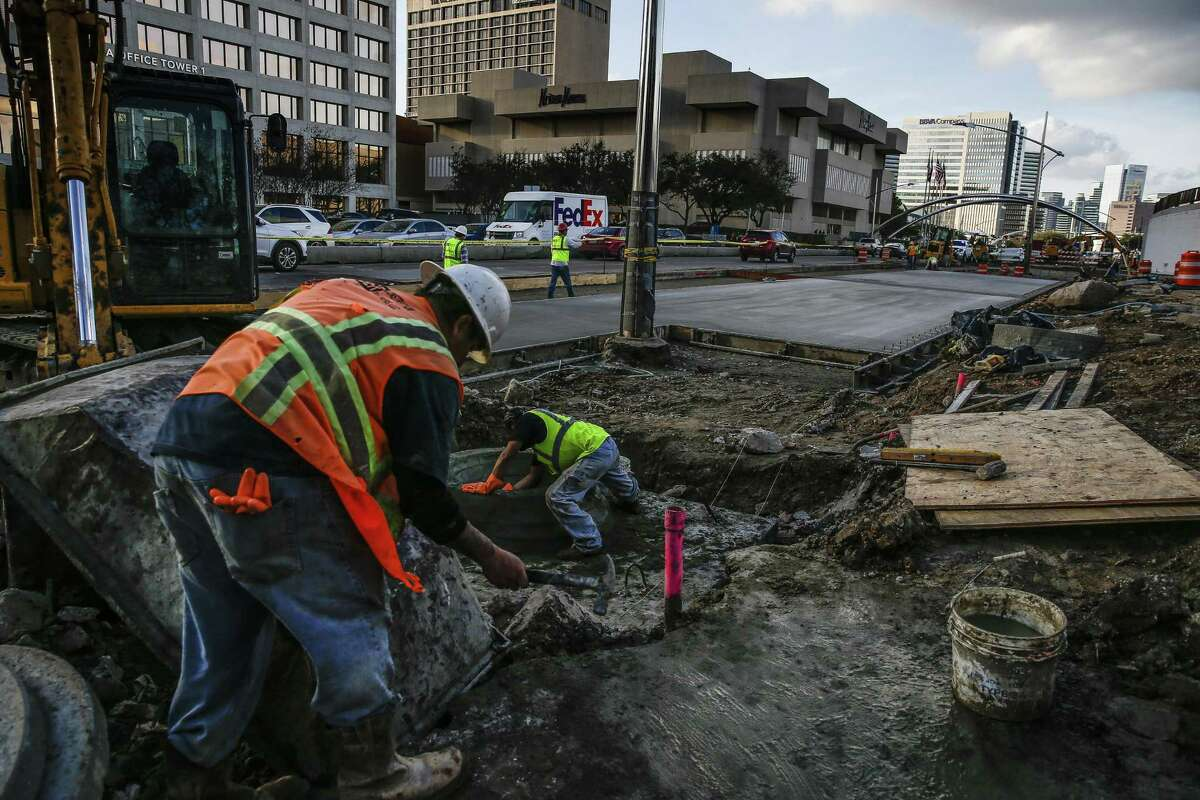 Construction crews work along Post Oak Boulevard on Feb. 14, 2018 in Houston. Construction costs have been on the rise according to an analysis of federal data by the Associated General Contractors of America.
