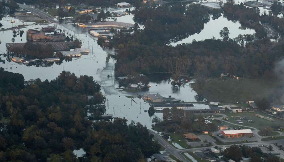Areas of Kinston, N.C., remained under water in 2018, as a result of Hurricane Florence. More than two weeks after Florence came ashore along the coast of North Carolina. Stamford-based insurer Navigators incurred third-quarter net losses and loss-related expenses of $11.8 million from Hurricane Florence and Typhoon Jebi. Photo: Scott Sharpe / TNS / Raleigh News & Observer