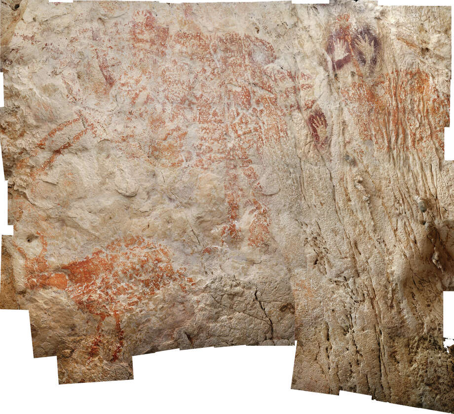 The worlds oldest figurative artwork from Borneo dated to a minimum of 40,000 years. Photo: Luc-Henri Fage / Handout