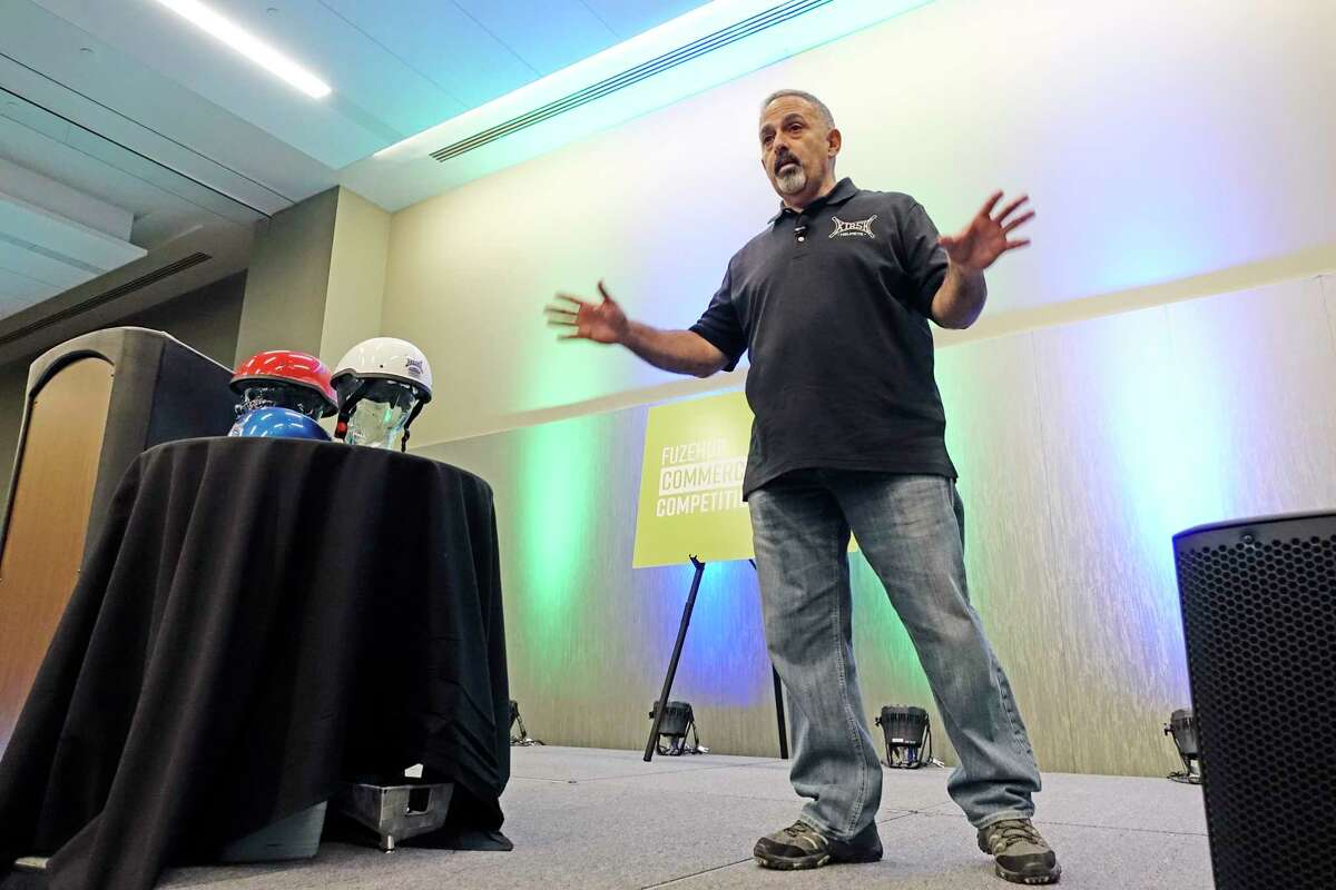 Donnie DeVito, co-founder and COO of KIRSH Helmets, presents during a finalist pitch session at the Fuzehub Commercialization Competition on Thursday, Nov. 8, 2018, in Albany, N.Y. (Paul Buckowski/Times Union)