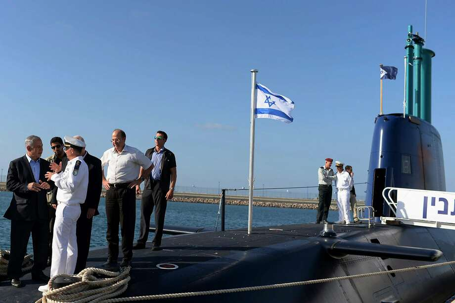 Prime Minister Benjamin Netanyahu (far left) inspected a German-made submarine in Haifa in 2014. Police say Netanyahu associates were bribed to help clinch the deal to buy German subs. Photo: Kobi Gideon / New York Times 2014