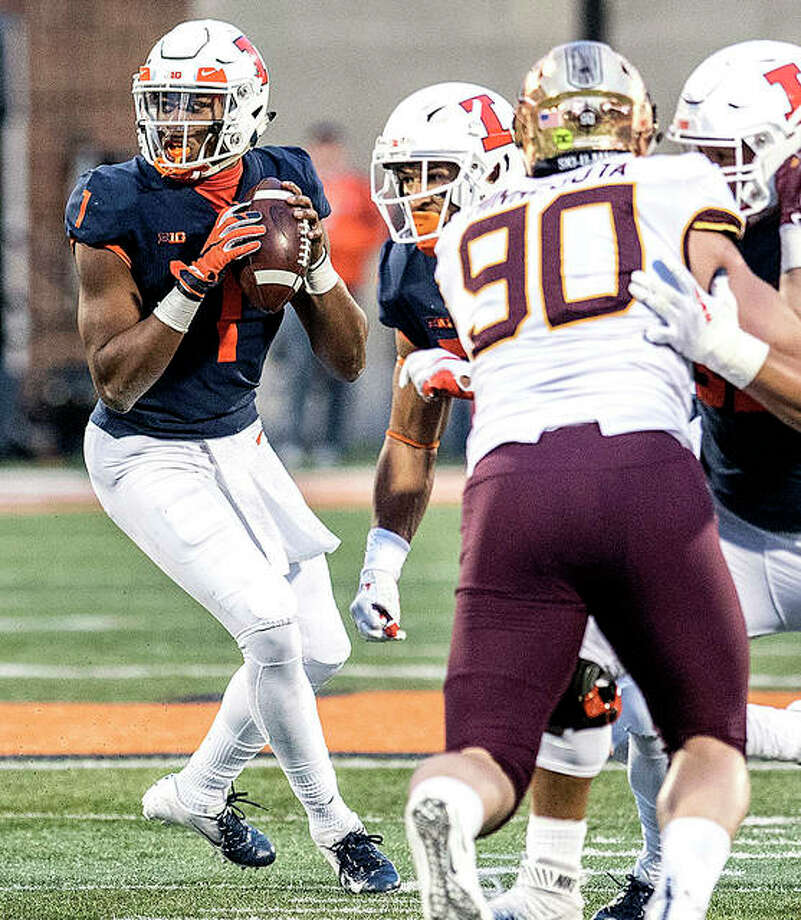 Illinois quarterback AJ Bush, Jr. (1) looks for an open man in Saturday's game win over Minnesota. Bush and the Illini will face his former team, Nebraska, Saturday. Photo: AP Photo