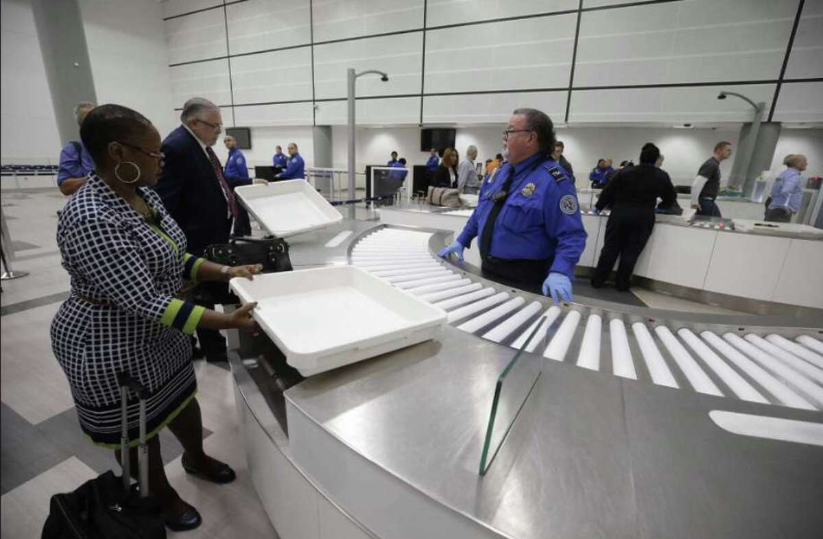 TSA personnel oversee new process at automated airport security screening at Houston Intercontinental Airport