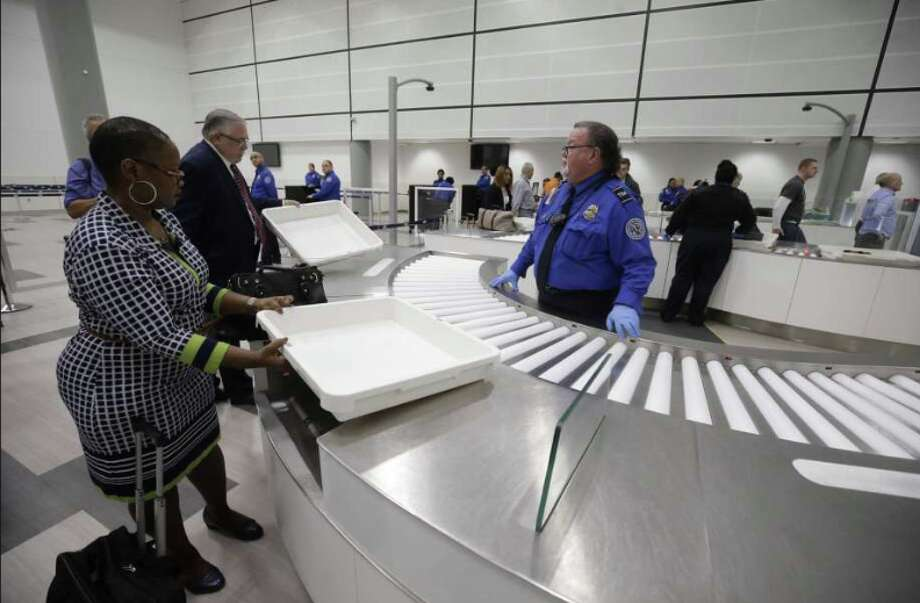 TSA personnel oversee new process at automated airport security screening at Houston Intercontinental Airport Photo: Houston Chronicle