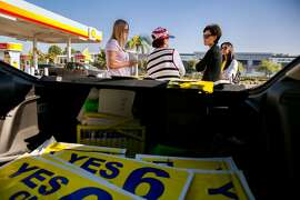 Republican House candidate Young Kim, second from right, campaigns at a service station in Brea, Calif., on Monday, Nov. 5, 2018. Kim was also campaigning for approval of California Proposition 6, a ballot initiative that would repeal the 2017 increase in the state's gas tax. (Jim Wilson/The New York Times)
