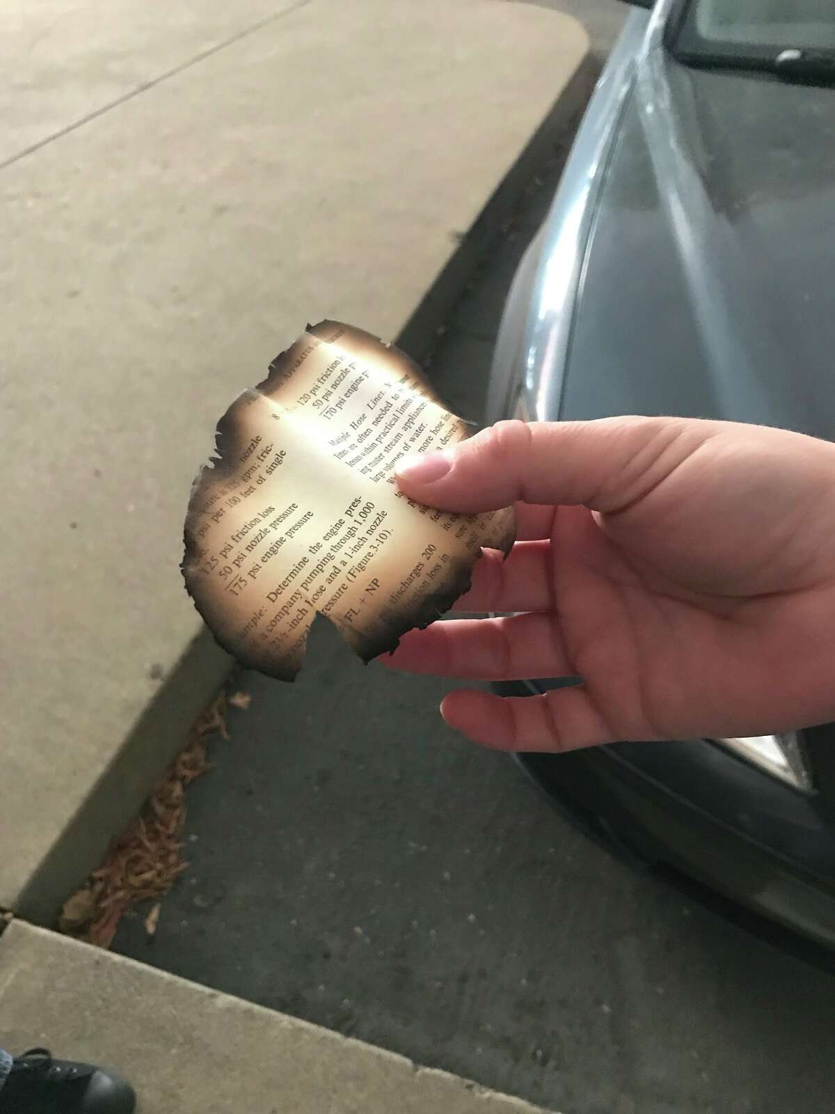 Nicole Kowalczyke of Chico stepped outside to look at smoke from the Camp Fire Thursday morning, and a singed piece of paper fell from the sky.