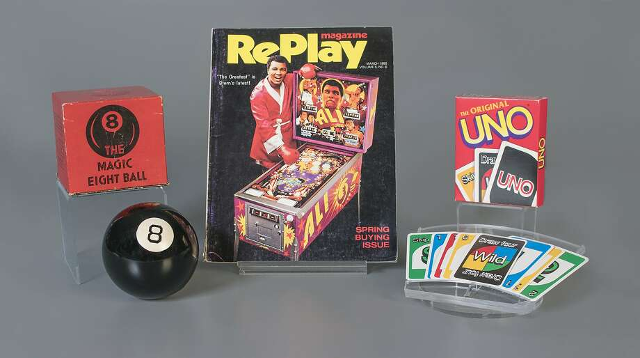 This October 2018 photo provided by The Strong museum shows the toys to be inducted into the National Toy Hall of Fame, inside the Rochester, N.Y., museum. The class of 2018 honored Thursday, Nov. 8, includes, from left, the Magic 8 Ball, pinball and the card game Uno. (Victoria Gray/The Strong via AP) Photo: Victoria Gray, Associated Press