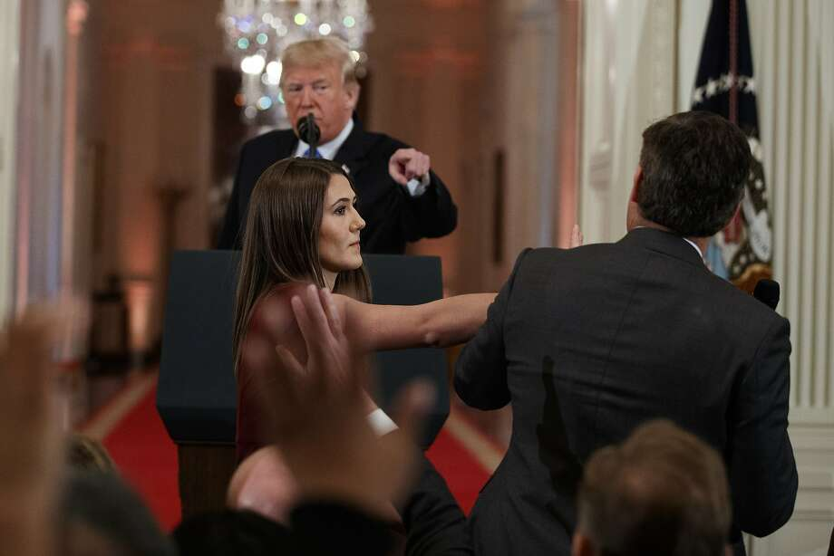 President Donald Trump looks on as a White House aide takes away a microphone from CNN journalist Jim Acosta during a news conference in the East Room of the White House, Wednesday, Nov. 7, 2018, in Washington. (AP Photo/Evan Vucci) Photo: Evan Vucci / Associated Press