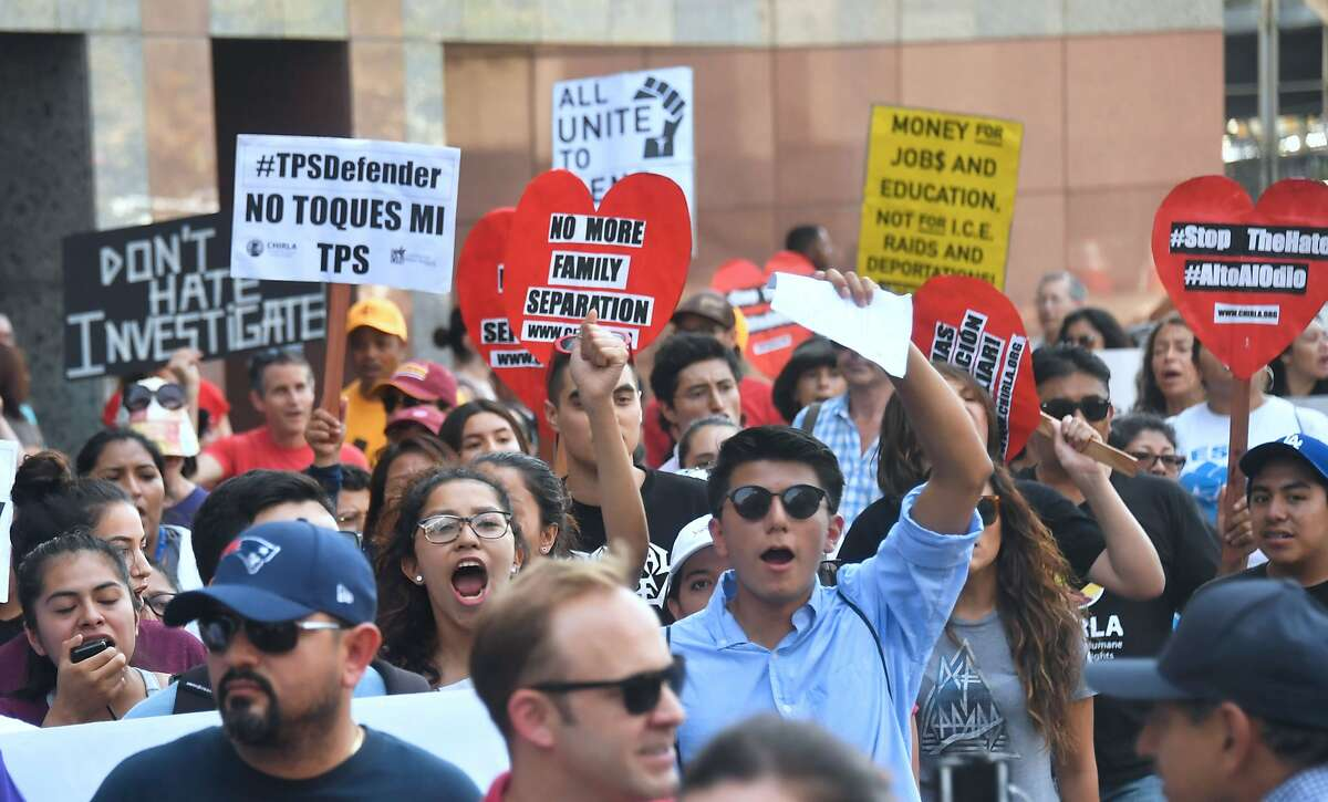 (FILES) In this file photo taken on September 1, 2017 young immigrants and supporters walk holding signs during a rally in support of Deferred Action for Childhood Arrivals (DACA) in Los Angeles, California. - The Trump administration is seeking the conservative-leaning Supreme Court's endorsement to kill the