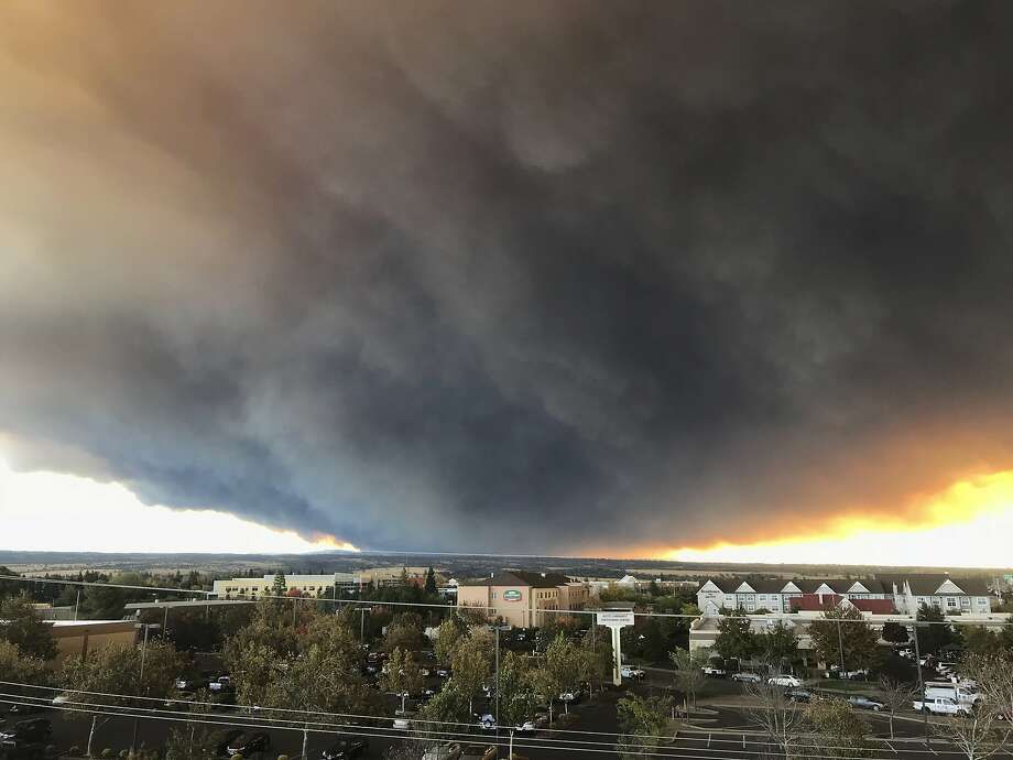 The massive plume from the Camp Fire, burning in the Feather River Canyon near Paradise, Calif., wafts over the Sacramento Valley as seen from Chico, Calif., on Thursday, Nov. 8, 2018. Authorities in Northern California have ordered mandatory evacuations in a rural area where the wildfire has grown to 1,000 acres (405 hectares) amid hot and windy weather. (David Little/Chico Enterprise-Record via AP) Photo: David Little, Associated Press