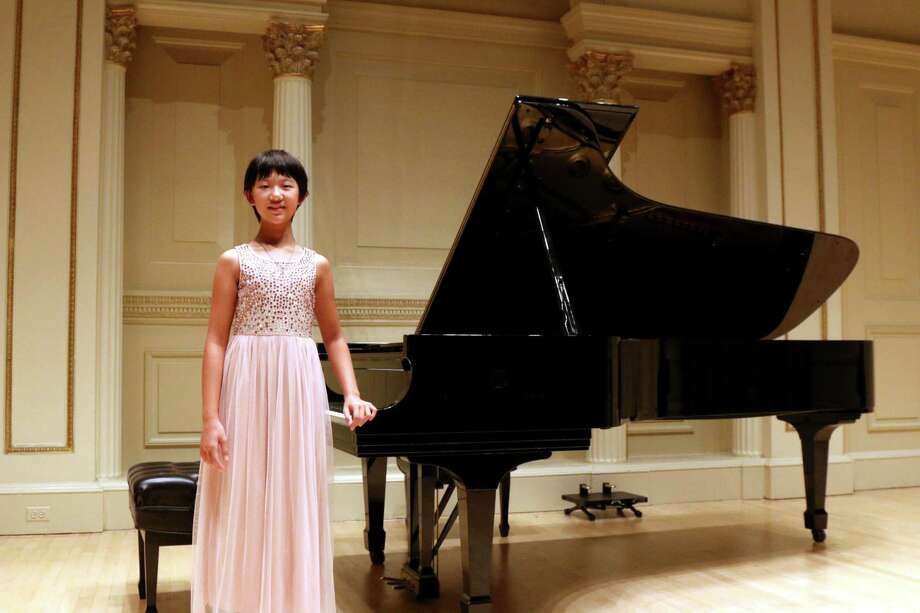 Fourth-grade student Katherine Huang fromFort Bend Christian Academy recently wowed the crowd at Carnegie Hall. Photo: Courtesy Photo