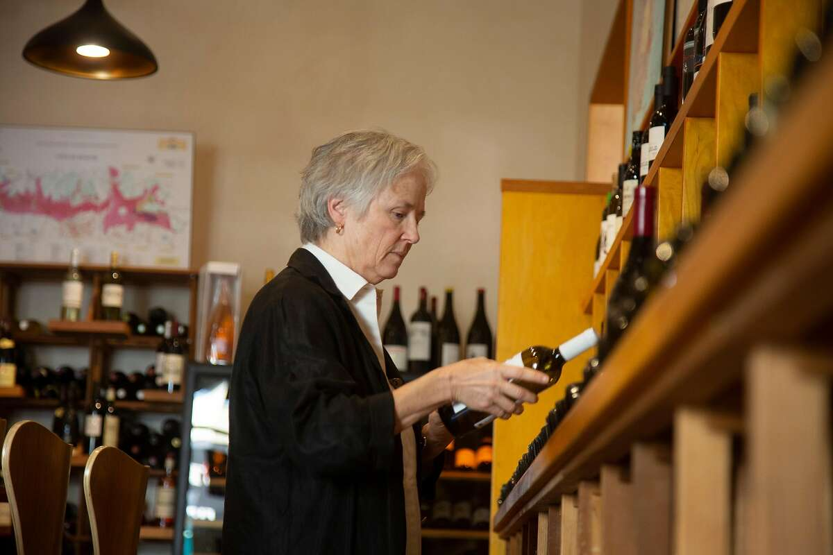 Patrice Boyle, owner of Soif, arranges wine bottles in her business on Thursday, 11/01, 2018 in Santa Cruz, California. Santa Cruz has the fourth highest female owned businesses in the country and female entrepreneurs in downtown recently created the Alliance of Women Entrepreneurs.