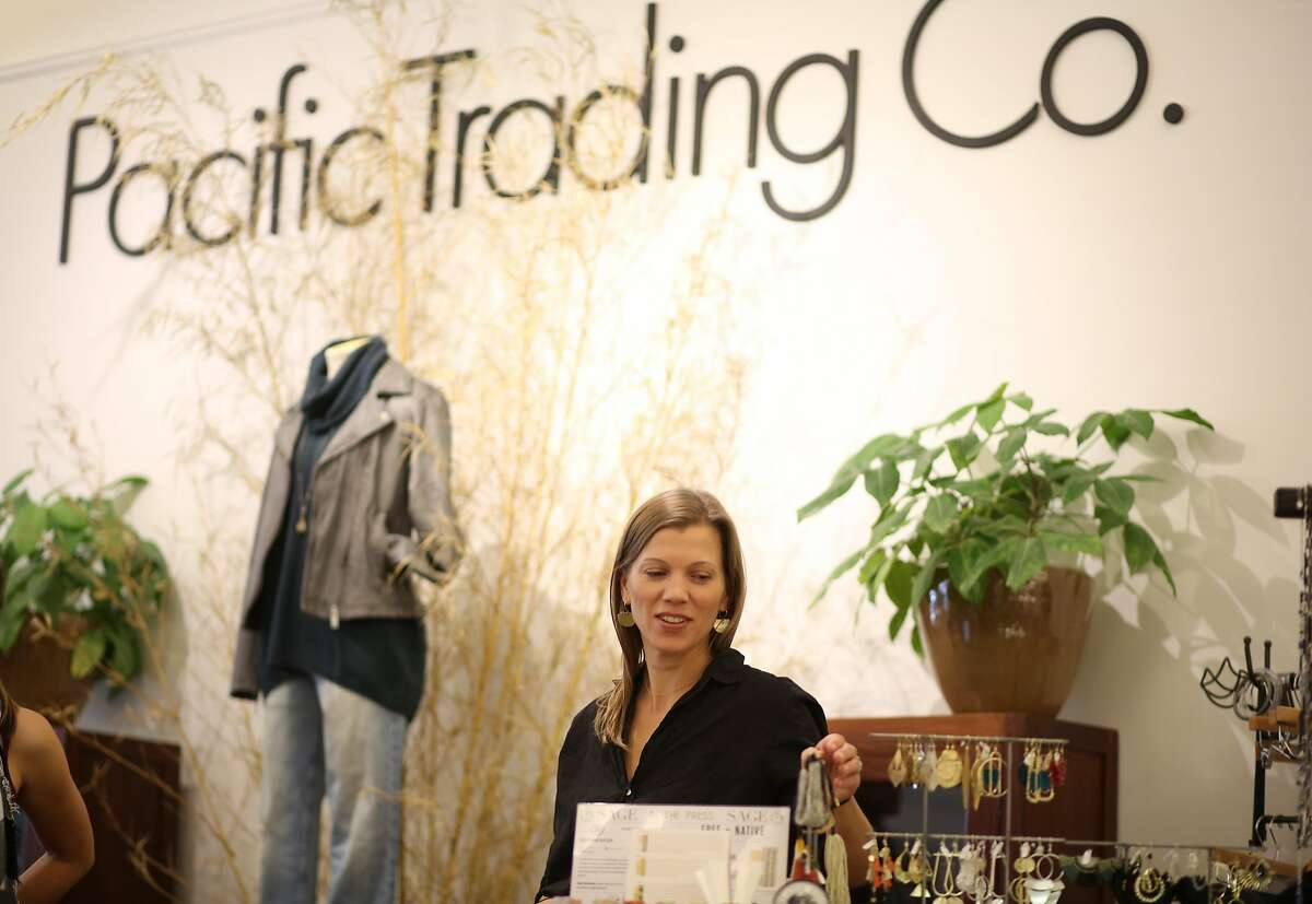 Rama Zoe Heinrich works at Pacific Trading Co. which she owns with her sister, Anandi Heinrich, on Thursday, 11/01, 2018 in Santa Cruz, California. Santa Cruz has the fourth highest female owned businesses in the country and female entrepreneurs in downtown recently created the Alliance of Women Entrepreneurs.