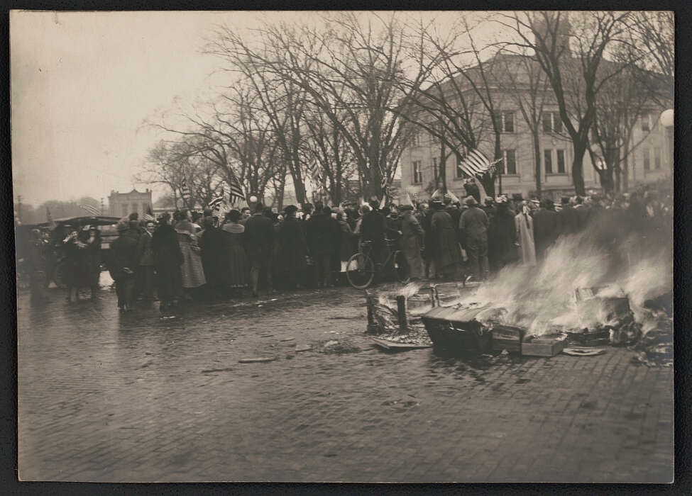 A pile of German high school textbooks burns on a street in Baraboo, Wisconsin, during an anti-German demonstration in 1918.