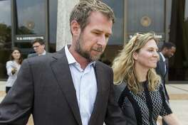 """Lubbock businessman Vernon """"Trey"""" Farthing III leaves the federal courthouse with his wife, Aurora, after a May 18 court appearance."""