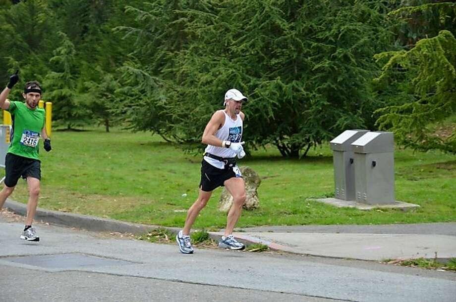 Gordon Harvey (right) passes through Golden Gate Park as he runs a marathon during a visit to San Francisco. The Alabama college professor tweets under the handle @HerbCaenDaily. Photo: Courtesy Gordon Harvey