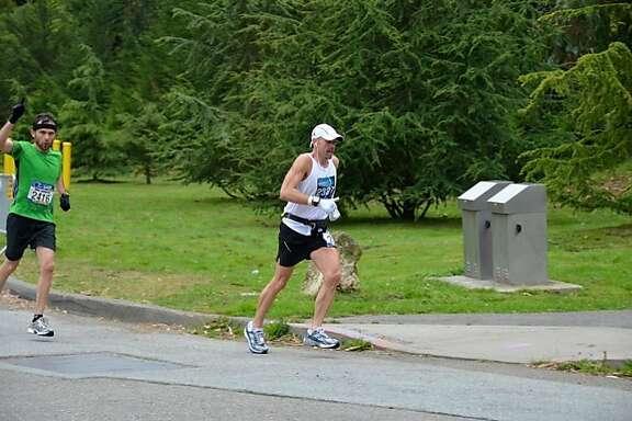 Gordon Harvey passes through Golden Gate Park as he runs a marathon.