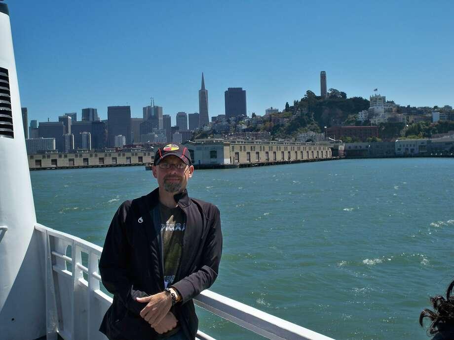 Gordon Harvey, who tweets as Herb Caen, rides the boat back from Alcatraz during a visit to San Francisco. Photo: Courtesy Gordon Harvey