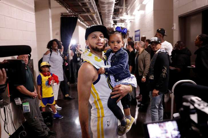 Stephen Curry holds his daughter Ryan after the Golden State Warriors defeated the Houston Rockets in Game 7 of the Western Conference Finals 101-92 to advance to the NBA Finals at the Toyota Center in Houston, Texas, on Monday, May 28, 2018.