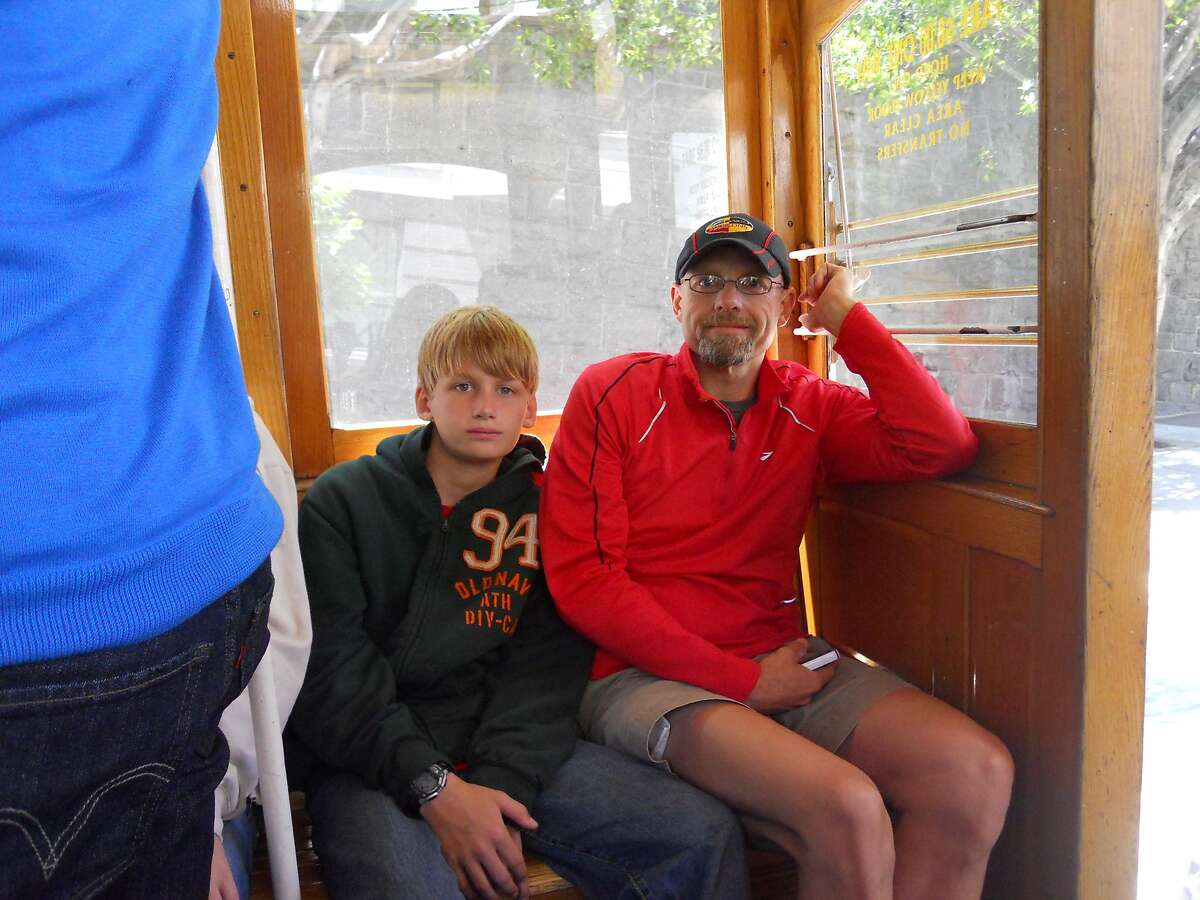 Gordon Harvey and his then 12-year-old son, Preston, riding a cable car