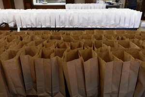 File photo of bagged lunches.