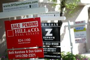 SAN FRANCISCO - MARCH 23:  Real estate signs are posted in front of homes for sale March 23, 2010 in San Francisco, California. Sales of existing homes fell for the third straight month, falling 0.6 percent in February.  (Photo by Justin Sullivan/Getty Images)