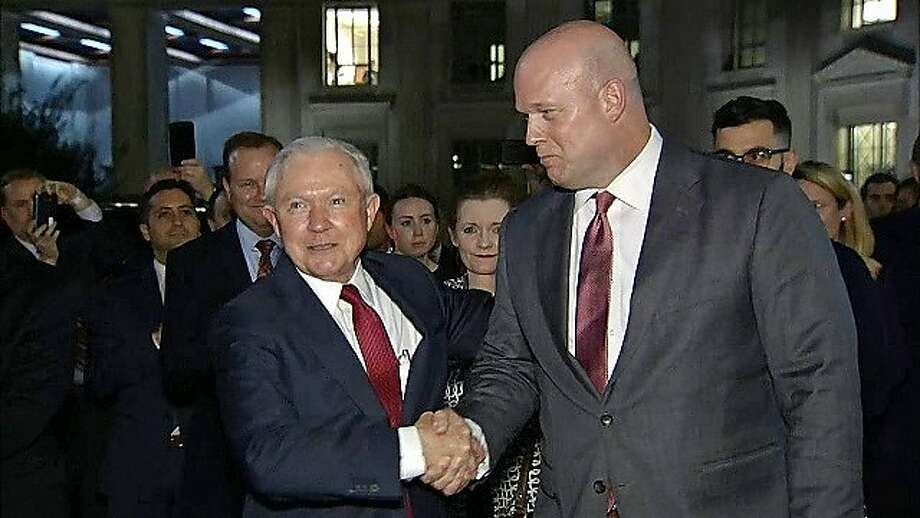 Former Attorney General Jeff Sessions shakes hands with his successor, Acting Attorney General Matthew G. Whitaker. Whitaker has no intention of recusing himself from overseeing the special counsel probe of Russian interference in the 2016 election, according to people close to him. Photo: Chronicle Editorial Board, InformationLiberation.com