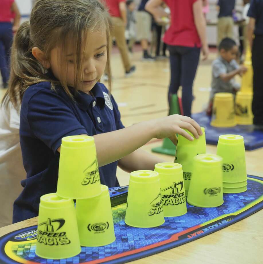 Washington STEM Academy first grader Teajan Brejd works on stacking cups 11/08/18 as students take part in cup stacking in conjunction with 40,000 others schools trying to set a new Guinness World Record for cup stacking by the most people at multiple locations on the same day. Tim Fischer/Reporter-Telegram Photo: Tim Fischer/Midland Reporter-Telegram