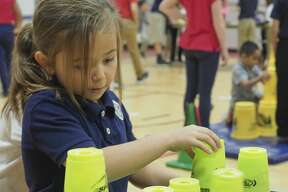 Washington STEM Academy first grader Teajan Brejd works on stacking cups 11/08/18 as students take part in cup stacking in conjunction with 40,000 others schools trying to set a new Guinness World Record for cup stacking by the most people at multiple locations on the same day. Tim Fischer/Reporter-Telegram