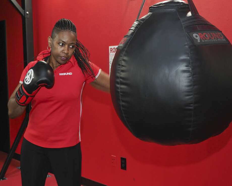 Cheryl Torres, owner of 9Round Fitness, works out on a heavy bag 11/08/18. Tim Fischer/Reporter-Telegram Photo: Tim Fischer/Midland Reporter-Telegram