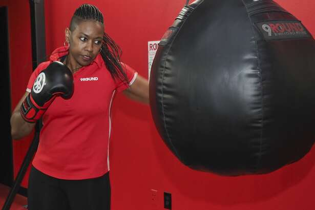 Cheryl Torres, owner of 9Round Fitness, works out on a heavy bag 11/08/18. Tim Fischer/Reporter-Telegram