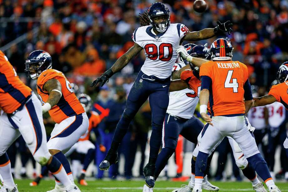 Jadeveon Clowney (90) of the Houston Texans leaps to defend a pass attempt by quarterback Case Keenum (4) of the Denver Broncos on November 4, 2018 in Denver, Colorado. Photo: Justin Edmonds, Stringer / Getty Images / 2018 Getty Images