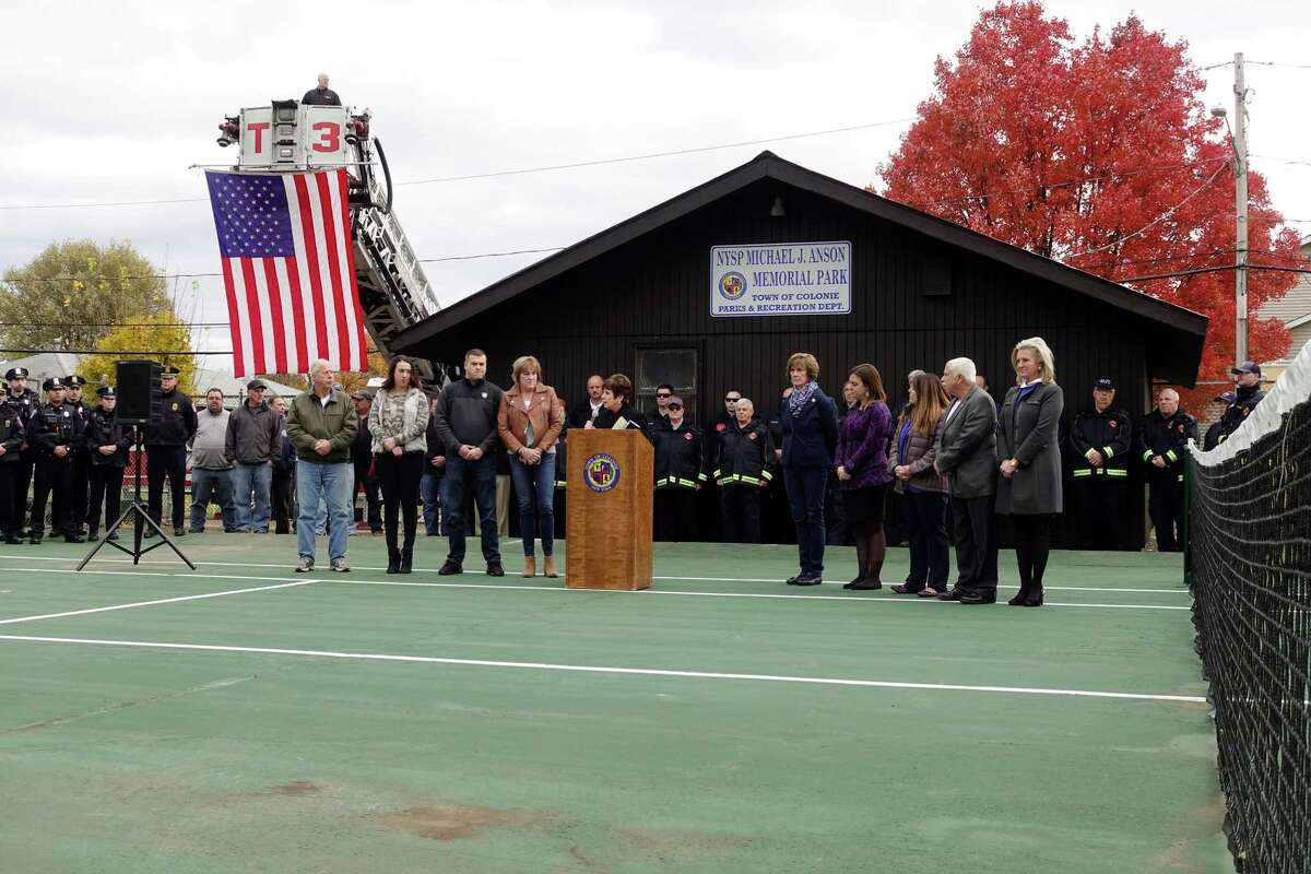 Colonie Town Supervisor, Paula Mahan, center at podium, addresses those gathered, including the wife and children of New York State Trooper Michael Anson on Thursday, Nov. 8, 2018, in Newtonville, N.Y. A ceremony was held at the newly named NYSP Michael J. Anson Memorial Park. Trooper Anson died from 9/11-related illness. (Paul Buckowski/Times Union)