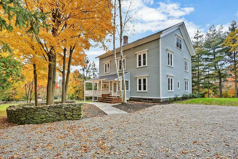 Built in 1861, the 3,508-square-foot antique colonial at 500 Plattsville Road in Trumbull once sat basically abandoned. Then it was purchased by the Ferri family, who spent more than two years restoring it, in a fashion that updated it with modern touches (new electrical, hot water, roof, and heat and air conditioning), while also maintain many original elements. These include the original, wide-plank fir flooring, the five original working fireplaces, and an old-fashioned foot bath in one of the bathrooms. Photo: Contributed Photo / Contributed Photo / Connecticut Post Contributed