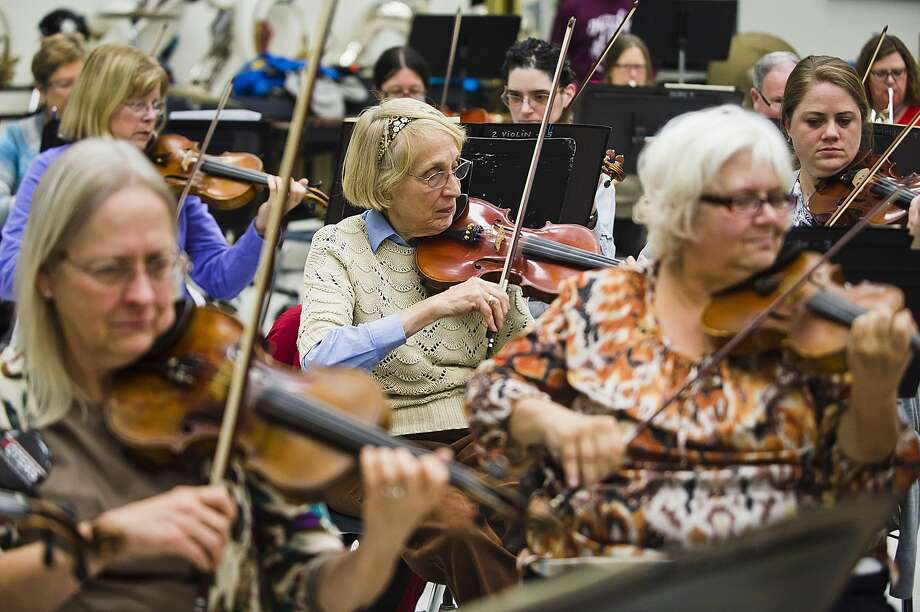 Members of the Midland Community Orchestra play during a rehearsal on Monday, Nov. 5, 2018 at Midland High School. (Katy Kildee/kkildee@mdn.net) Photo: (Katy Kildee/kkildee@mdn.net)