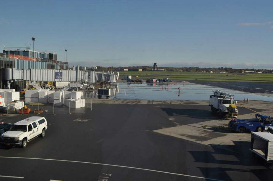 Albany International Airport's deluge firefighting system flooded the tarmac Tuesday morning after it was accidentally triggered during roof repairs. Photo: Albany International Airport