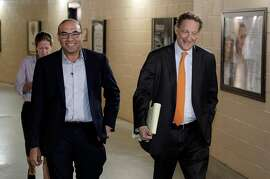 Farhan Zaidi walks toward the press conference room with Giants CEO Larry Baer before Baer introduced him as the new president of baseball operations during a press conference at AT&T Park, in San Francisco, Calif., on Wednesday, November 7, 2018.