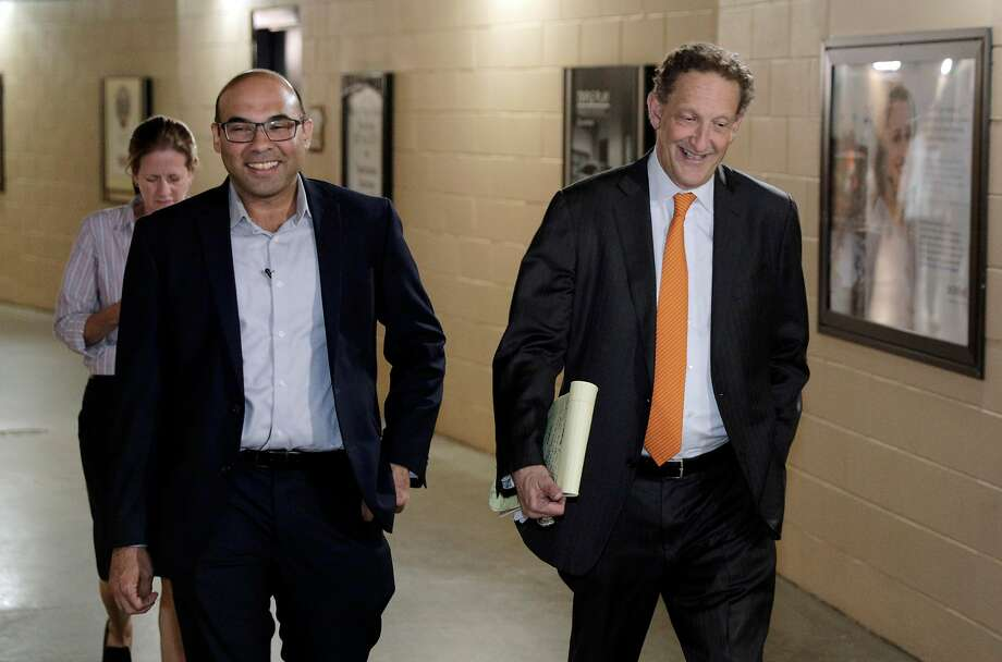 Farhan Zaidi walks toward the press conference room with Giants CEO Larry Baer before Baer introduced him as the new president of baseball operations during a press conference at AT&T Park, in San Francisco, Calif., on Wednesday, November 7, 2018. Photo: Carlos Avila Gonzalez / The Chronicle
