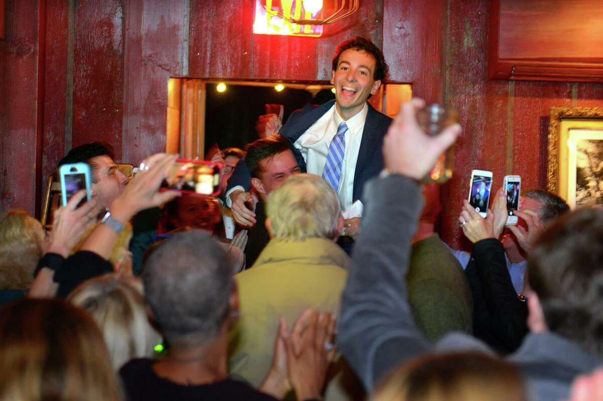 Democrat Will Haskell is lifted up by a supporter after learning he just defeated incumbent Republican Toni Boucher for state senate during a post election party at the Little Barn in Westport on Tuesday.