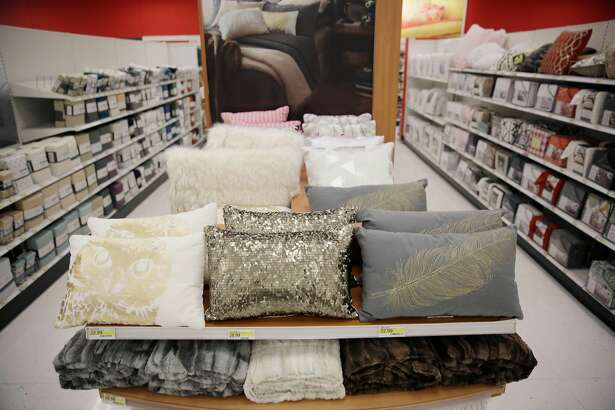 A Visual Impact Area (VIA) in home decor include pillows with a holiday theme at Target on Tuesday, November 24, 2015 in San Francisco, Calif.