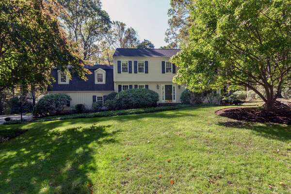 The Garrison colonial at 85 Kellogg Drive sits on a secluded parcel of nearly two acres down a long, tree-lined driveway.