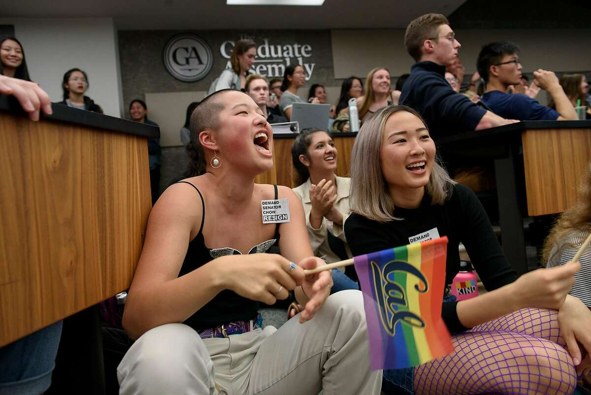 Students Lindsey Chung, left, and Tatiana Su wave flags and yell in response to a speaker's comments during an Associated Students of the University of California meeting held at the University of California in Berkeley, Calif, on Wednesday November 7, 2018. Student Senator Isabella Chow is facing backlash for abstaining from a resolution condemning the Trump administration's anti-LGBTQ actions in new Title IX regulations.