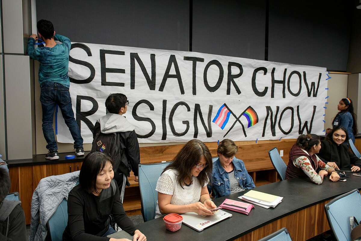 Students hang a sign asking for student senator Isabella Chow to resign, during an Associated Students of the University of California meeting held at the University of California in Berkeley, Calif, on Wednesday November 7, 2018. Chow is facing backlash for abstaining from a resolution condemning the Trump administration's anti-LGBTQ actions in new Title IX regulations.