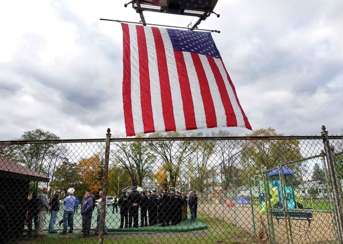 Members of law enforcement gather for a ceremony at the newly named NYSP Michael J. Anson Memorial Park on Thursday, Nov. 8, 2018, in Newtonville, N.Y. Anson died from 9/11-related illness. (Paul Buckowski/Times Union)