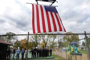 Members of law enforcement gather for a ceremony at the newly named NYSP Michael J. Anson Memorial Park on Thursday, Nov. 8, 2018, in Newtonville, N.Y. New York State Trooper Anson died from 9/11-related illness.     (Paul Buckowski/Times Union)