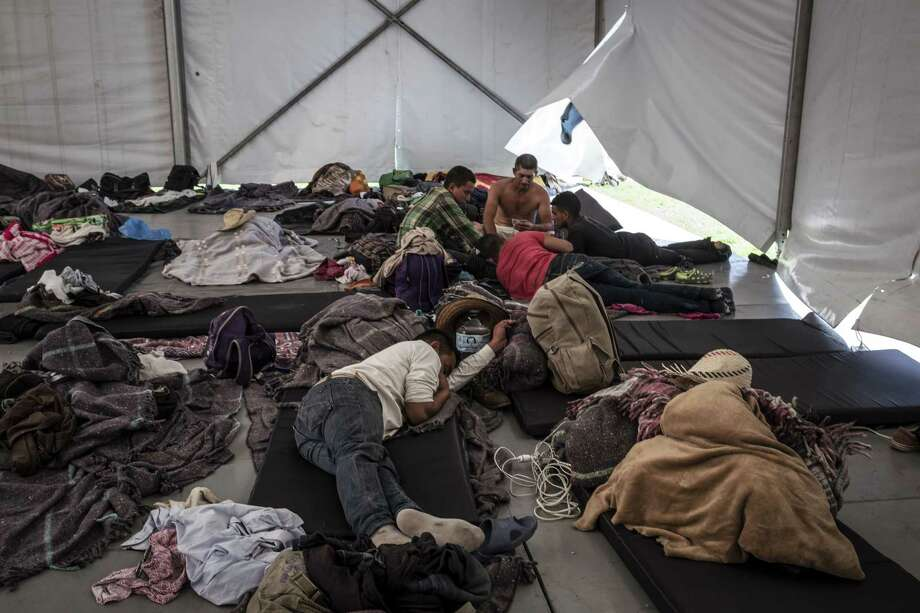 Central American migrants take temporary shelter at Jesus Martinez Palillo stadium in Mexico City, on Monday. Photo: Bloomberg Photo By Jacky Muniello/Bloomberg / Bloomberg